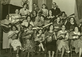 Group of union members playing guitars and mandolins on stage