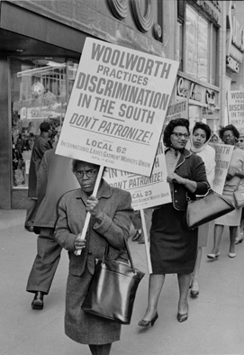 African American woman picketing Woolworth's discrimination in the south