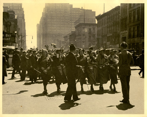 ILGWU Local 22 members carrying pennants and marching in the May Day Parade, 1934.