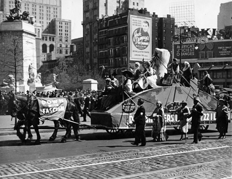 ILGWU Local 22 members in ethnic dress on a float pulled by horses with a banner reading Down with Fascism. Part of the May Day Parade 1934.