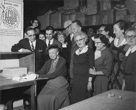 Eleanor Roosevelt sews in first ILGWU union label at Karyl Lee shop, February 14, 1961.