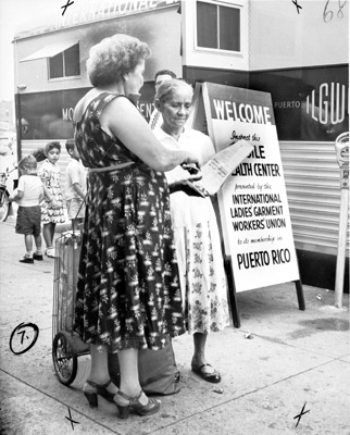 Women outside an ILGWU mobile health center in Puerto Rico