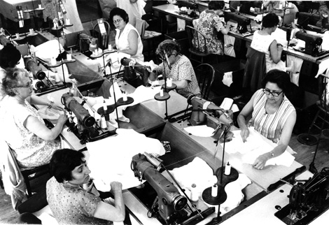Rows of women sewing in a garment shop