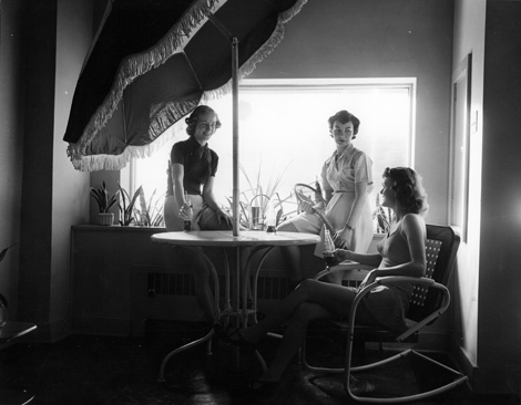 Women conversing and drinking soda at Unity House, circa 1955