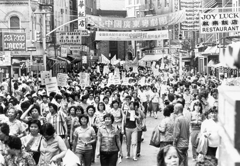 Members of ILGWU Local 23-25 march through Chinatown